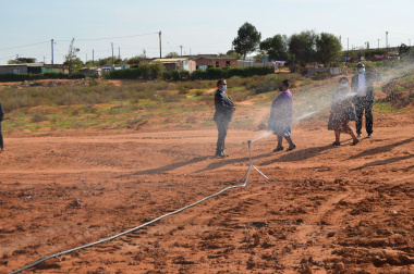 Irrigation with ministers Didiza and Meyer in the background