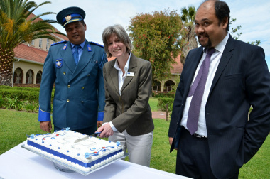 Head of Department of Transport and Public Works, Jacqui Gooch cuts the 25th Anniversary cake as Farrel Payne (Head of College) and Kyle Reinecke (Head of Branch: Transport Management) look on.
