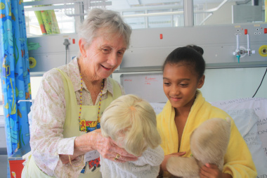 Jean Harker playing with Lisa Rubain (9) in the ward at Red Cross War Memorial Children's Hospital.