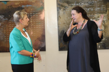Jeanette explaining the intricacies of the paintings to Minister Marais.