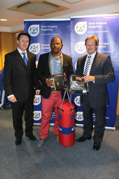 JP Naude, Ngcofe Macibela from Sai Infantry Boxing Club and Minister of DCAS Theuns Botha