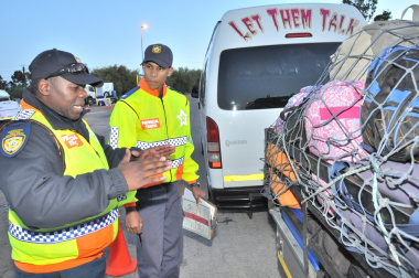 Keanon Cloete learns from experienced traffic officer Lunga Fuzani.