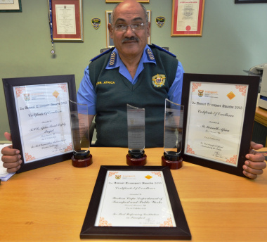 Kenny Africa with the three awards he collected in Bloemfontein.