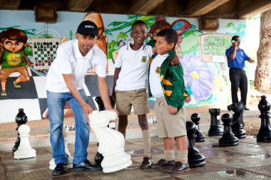 Kenny Solomon posed with Hero Kedama and  Ryan Daniels at giant chess board under a bridge in Observatory, Cape Town. Photo by Colourworks