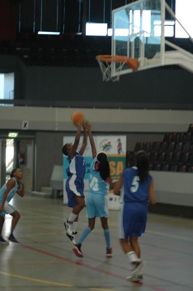 Khanyisa Mpako shows her skills on the basketball court.