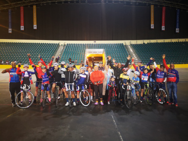 Minister Anroux Marais with the Kinetic Cycling Club