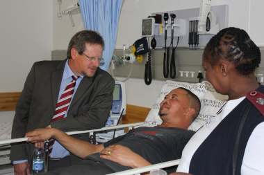 Minister Theuns Botha with patient Gashwin Spies and sister Florence Lupuwana in the emergency centre.