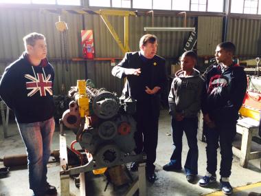 Kyle Duminy, Minister Grant, Duhayne Sacco and Justin Jansen at the Belville Mechanical Workshop.