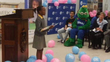 Learner from Masiphatisane Primary School delivers a reading presentation