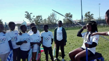 Learner is shown how to throw javlin at Paralympic Games