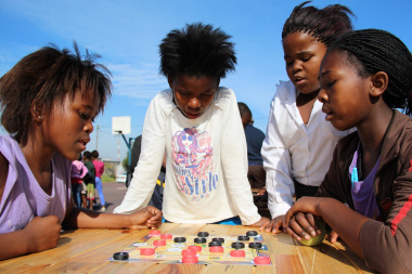 Learners at Mosheshe Primary School enjoy playing Marabaraba board games.