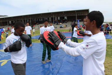 Learners excitedly participating in a kick boxing demonstration.