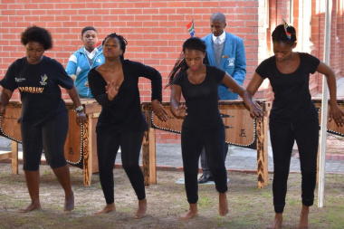 Learners from Chris Hani High School performing a dance piece during the opening ceremony.