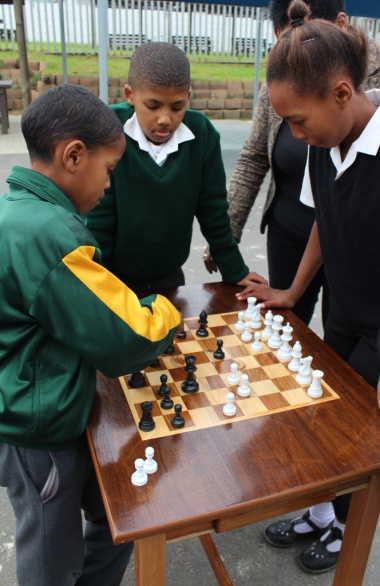 Learners from Groenheuwel and Dal Josaphat Primary Schools enjoying the chess tables at the library.
