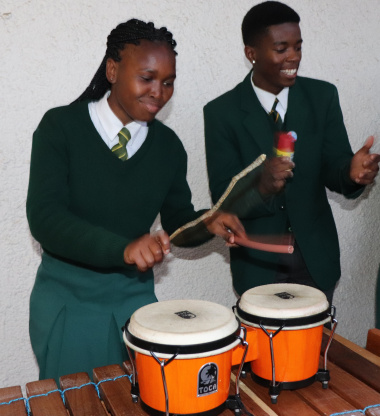 Learners from Langa High School use a spice container, pipe and stick to support the viby marimbas on the veranda of the Cape Medical Museum