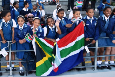 Learners from St Augustine's Primary School waited anxiously for the Olympians and Paralympians to arrive at the Green Point Athletics Stadium.