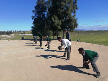 Learners learn the basics of softball at the Olympic Values roadshow in Saron