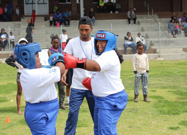 Learners participate in a boxing demonstration