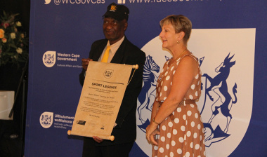 """Legendary boxer and trainer, Mzamo """"Smoking Joe"""" Mandyu, receives his cap and scroll from Minister Anroux Marais on Thursday."""