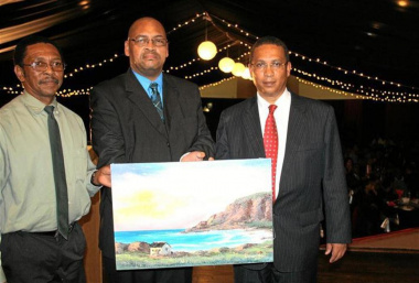 Local artist Anthony Noble Mr Charles Standers (George Municipality) and Dr Ivan Meyer with the oil painting of the Gwaing River mouth. Photo by Christo Vermaak (George Herald)