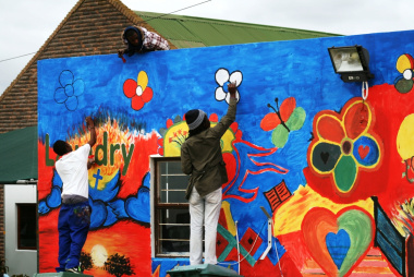 Local artists working hard at painting the mural for Siyabonga Care Village.