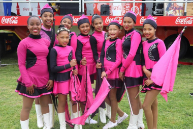 Local drum majorettes entertain the crowd with their dainty routines