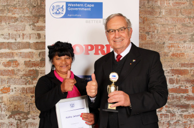 Gerrit van Rensburg, Western Cape Minister of Agriculture, with Kathy January, the Witzenberg region's candidate for Western Cape Farm Worker of the Year 2013.