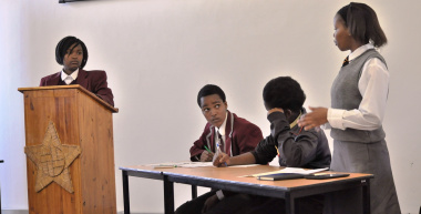 Making a point during the provincial debate competition.