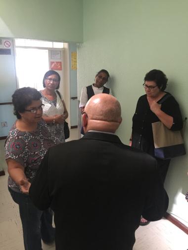 Manager Val Kadalie talks to MEC Fritz