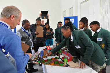 Marhele Hlumelo of Dr Nelson Mandela High School reports on her team's road safety model.