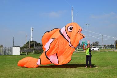 Mari preparing their handmade Nemo kite to take flight.