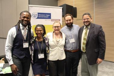 MC Afrika Melane, with speakers Lusanda Gwayi, Premier Helen Zille, Dr Nic Spaul and Brent Walters
