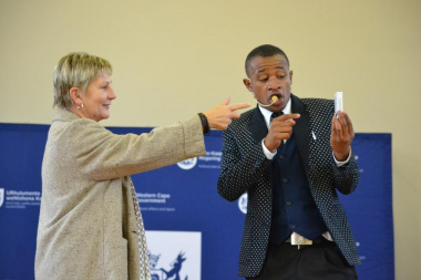 MC Mawonga Gayiya asked Minister Anroux Marais to assist him with one of his magic tricks on stage
