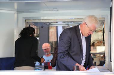 MEC Alan Winde certifying civilians' documents