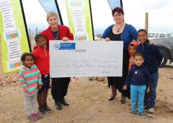 MEC of DCAS Anroux Marais and Executive Mayor of Breede Valley Municipality Antoinette Steyn with children from the Avian Park community
