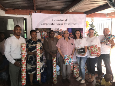 MEC visit to Baphumelele for Xmas party