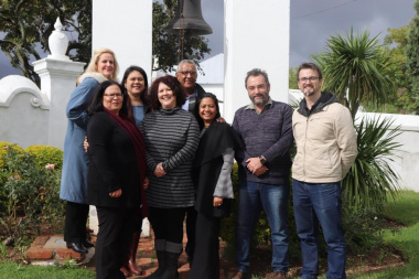 Michael Janse van Rensburg and the managers of the various museums in the Cape Winelands at the historic bell of the Oude Kerk Volksmuseum in Tulbagh