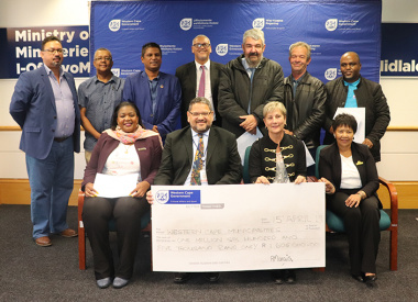 Minister Anroux Marais and DCAS HOD Brent Walters with relevant Mayors at the cheque handover