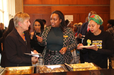 Minister Anroux Marais and Marlene le Roux, CEO of Artscape testing some Angolian food
