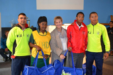 Minister Anroux Marais (centre) with the coaches and learners from some of the schools who received kits