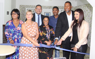 Minister Anroux Marais, chief Mandla Mandela and his wife Nosekeni Rabia Mandela officially open the exhibit, in the kitchen of the Nelson Mandela House at Drakenstein Correctional Centre