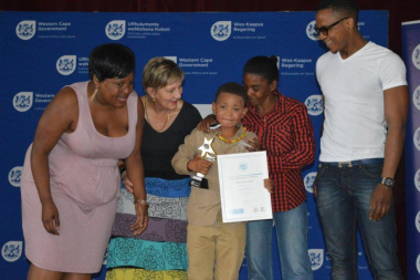 Minister Anroux Marais congratulates young Aiden who won the award for Best Supporting Actor
