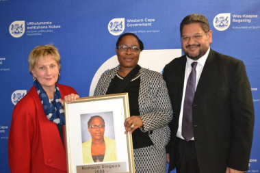 Minister Anroux Marais, Director Nomaza Dingayo and HOD Brent Walters with one of the new photos that was unveiled