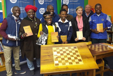 Minister Anroux Marais handling over the chess tables to the Friends of the Nazeema Isaacs Library in Khayelitsha.