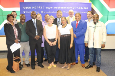 Minister Anroux Marais, DCAS HOD Brent Walters, WCPGN and ex-officio members with DCAS staff at the inauguration at Head Office in Cape Town