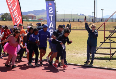 Minister Anroux Marais kicks off the fun walk at the Better Together Games
