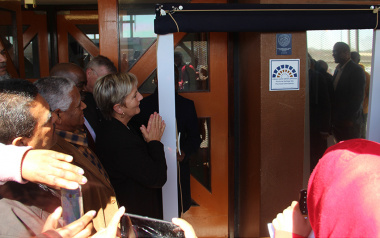 Minister Anroux Marais (left) unveils the new Heritage Western Cape plaque at the Rocklands Community Centre in front of a crowd of onlookers in Mitchell's Plain on Tuesday.