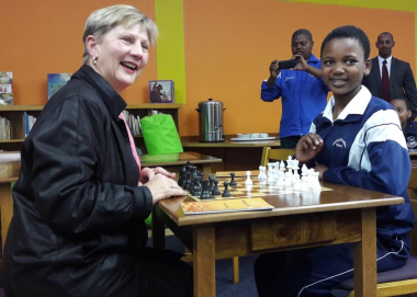 Minister Anroux Marais making use of the chess tables with national chess champion Sinoxolo Sokoyi.