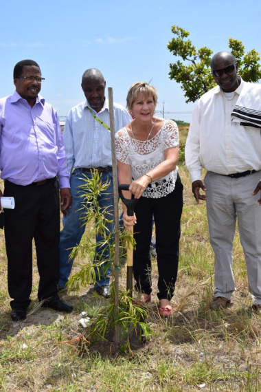 Minister Anroux Marais planting one of the 20 trees donated to the initiation site in Nyanga.