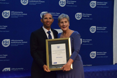 Minister Anroux Marais with Jeff Coetzee, recipient of a Ministerial Commendation